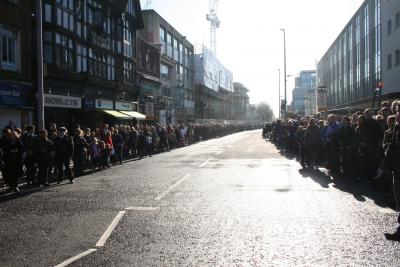 Crows lined the street to witness the Deputy Lord Lieutenant of Hampshire and the Mayor of Southampton lead the band and serving and ex service personnel on a march through Southampton's main thoroughfare image Ann MacGillivray