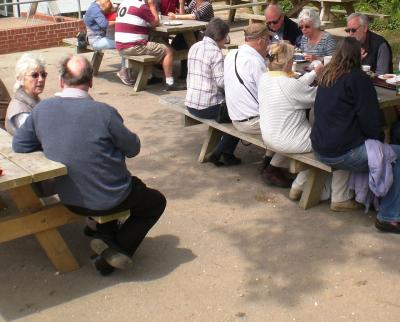 Members enjoying the sunshine and lunch at Lepe. image Will Temple