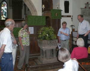 The churchwarden kindly explained some of the features of minstead Church. Image Will Temple