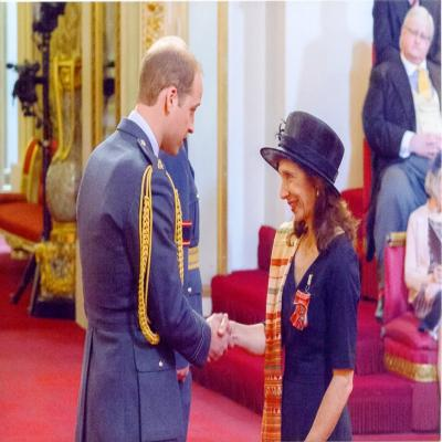 HRH The Duke of Cambridge presenting the MBE to Jill Ghanouni [May 2015]